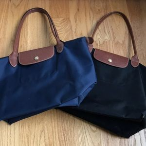 Longchamp bags in navy & bag. In fair condition